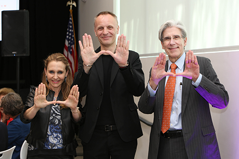Felicia Knaul, Richard Horton, Julio Frenk throwing up The U and Lancet Commission Launch